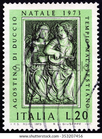"ITALY - CIRCA 1973: A stamp printed in Italy from the ""Christmas. Sculptures by Agostino di Duccio "" issue shows musician angels, circa 1973.  - stock photo"