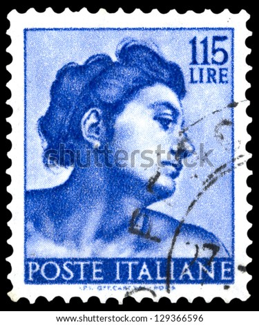 "ITALY - CIRCA 1961: A stamp printed in Italy shows a head of slave (Michelangio), without inscription, from the series ""Frescoes in the Sistine Chapel"", circa 1961"