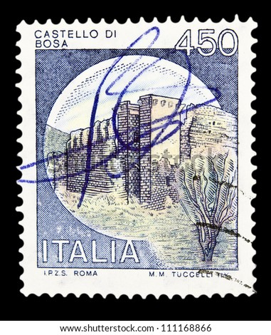 """ITALY - CIRCA 1980: A stamp printed in Italy, shows castle Bosa, Nuoro with the same inscription, from the series """"Italian castles"""", circa 1980 - stock photo"""
