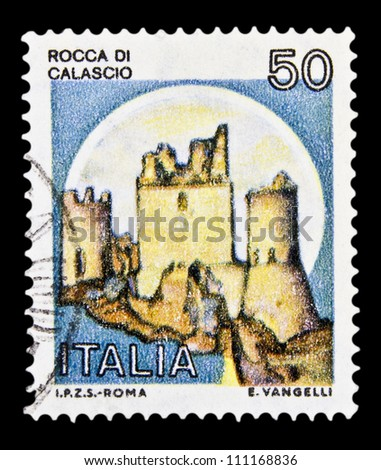 """ITALY - CIRCA 1980: A stamp printed in Italy, shows castle Rocca Calascio with the same inscription, from the series """"Italian castles"""", circa 1980 - stock photo"""
