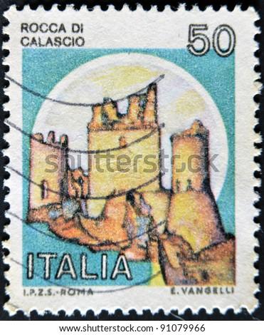 ITALY - CIRCA 1980: A stamp printed in Italy, shows Rock of Calascio, Italian series of castles , circa 1980 - stock photo
