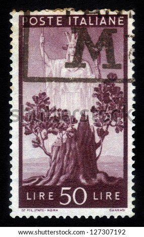 "ITALY - CIRCA 1945: A stamp printed in Italy, shows the ""Italia"" and Sprouting Oak Stump, from the series ""Italia"" , circa 1945"