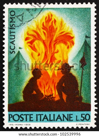 ITALY - CIRCA 1968: a stamp printed in the Italy shows Scouts at Campfire, circa 1968 - stock photo