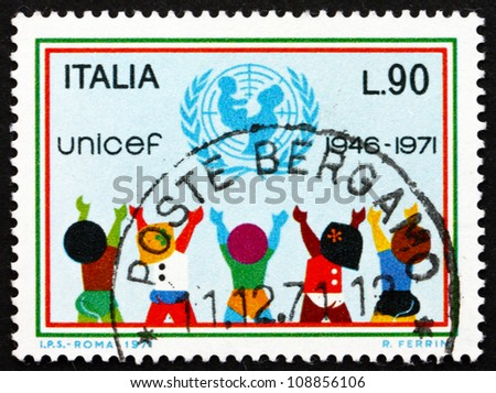ITALY - CIRCA 1971: A stamp printed in the Italy shows UNICEF Emblem and Children, 25th Anniversary of UNICEF, circa 1971