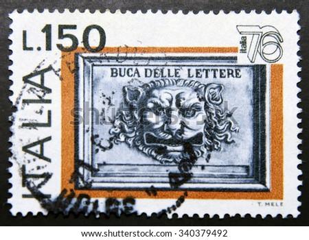 ITALY - CIRCA 1976: stamp shows Mail box - stock photo
