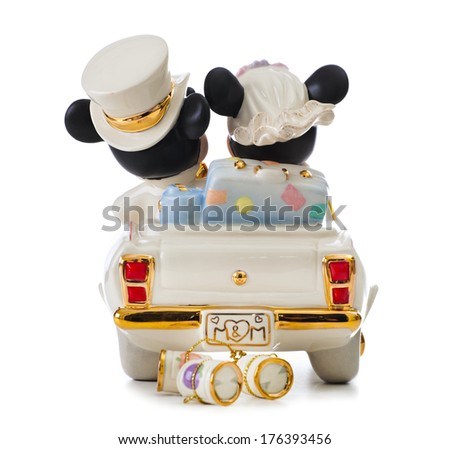 ITALY - FEBRUARY 12, 2014: Minnie's Dream honeymoon Disney, wedding cake topper by Lenox. The object is in porcelain 24 karat gold. Mickey Mouse and Minnie Mouse in the car are leaving for honeymoon. - stock photo