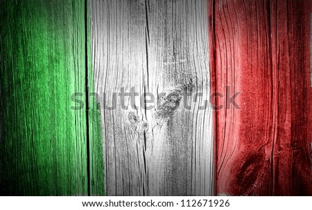 Italy flag on old wooden wall background or texture - stock photo