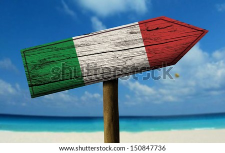 Italy flag wooden sign with a beach on background - Europe - stock photo