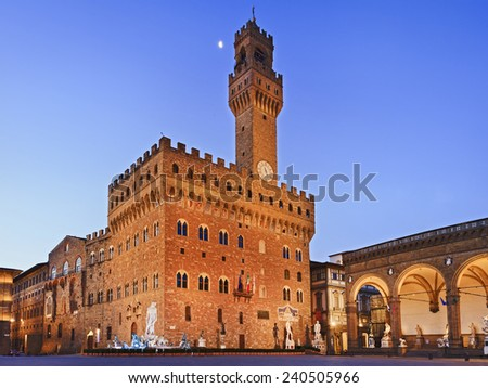 Italy Florence Palazzo Vecchio square at sunrise with moon ancient walls and towers of historic buildings - stock photo