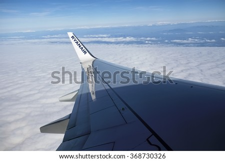 Italy; 26 January 2016, flying airplane wing - EDITORIAL - stock photo