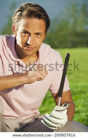 Italy, Kastelruth, Man on golf course smiling