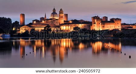Italy Mantua Duke's palace and castle panoramic view at sunset with reflection in still lake water