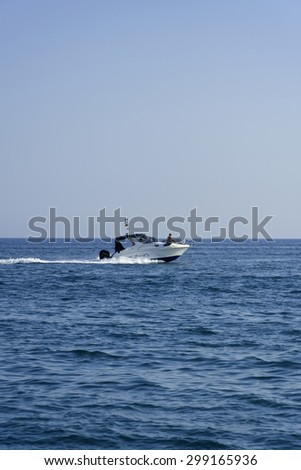 Italy, Mediterranean Sea; 18 july 2015, off the South-East sicilian coast, people cruising on a motor boat - EDITORIAL