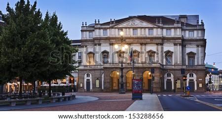 italy milan city landmark building of La Scala opera facade view at sunrise illuminated neo-classical house - stock photo