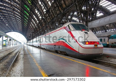 ITALY, MILAN-MAI 7,2014: The modern high-speed train at the station. The central railway station of Milan (ital. Milano Centrale) is one of the largest stations of Europe - stock photo