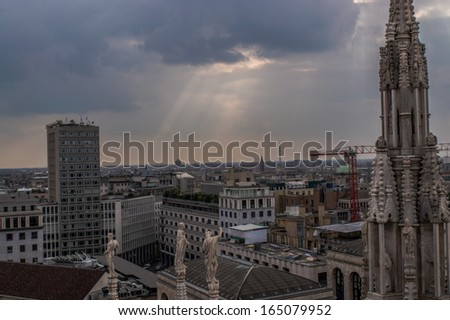 Italy, Milan skyline with sun rays and gothic spire