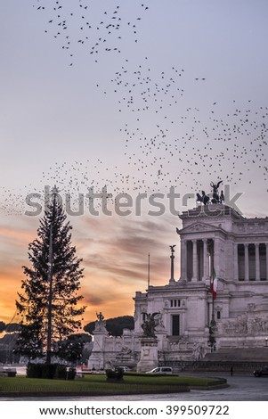 Italy, Rome, Piazza Venezia, 13 December 2015 - The sky is colored orange in a beautiful sunrise in Piazza Venezia - stock photo