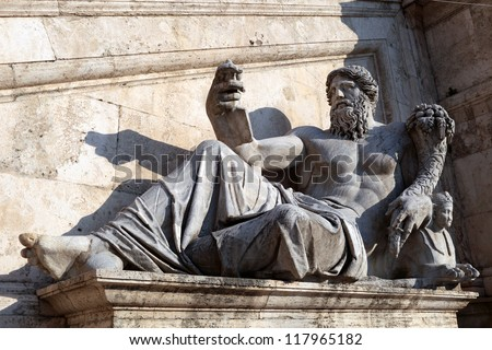 Italy, Rome: profile of the river god of the Nile in front of the facade of Palazzo Senatorio (Capitoline). Statue of the XVI c. - stock photo