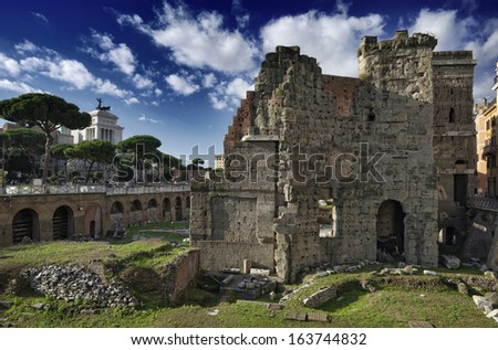 Italy, Rome, Roman Forum (Forum of Nerva, 97 A.D), roman ruins. The Victorian Palace in the background