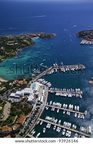 Italy, Sardinia, Olbia province, aerial view of the Emerald Coast, the Tyrrhenian Sea and Porto Cervo marina - stock photo