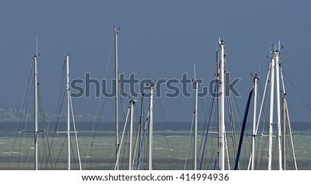 Italy, Siciliy, Mediterranean sea, Marina di Ragusa, sailing boat  masts in the marina - stock photo
