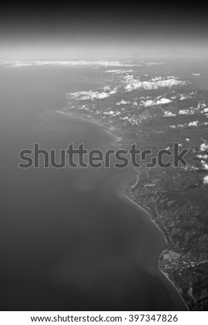Italy, Sicily, aerial view of the sicilian countryside and the Tyrrhenian Sea coastline