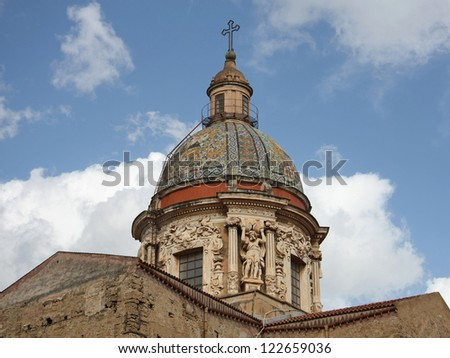 Italy, Sicily.Carmine Maggiore dome against a blue sky and clouds, Palermo.