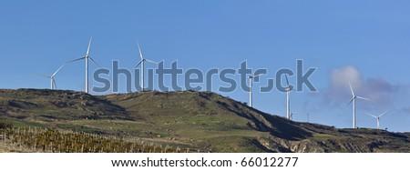 ITALY, Sicily, countryside near Agrigento, Eolic energy turbines - stock photo