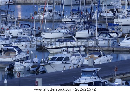 Italy, Sicily, Mediterranean sea, Marina di Ragusa; 29 may 2015, luxury yachts in the marina at sunset - EDITORIAL