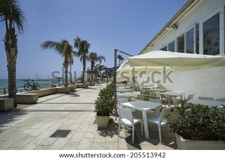 Italy, Sicily, Mediterranean sea, Marina di Ragusa (Ragusa Province), view of the seafront with palm trees