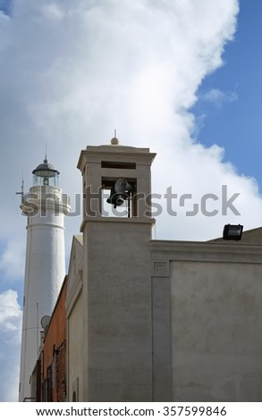 Italy, Sicily, Mediterranean sea, Punta Secca (Ragusa Province), view of the church bell tower and the lighthouse