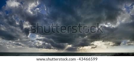 Italy, Sicily, mediterranean sea, southern coast, dark clouds in the sky - stock photo