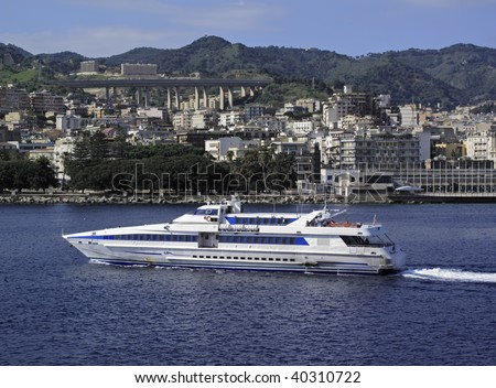 Italy, Sicily, Messina view of the town and the ferryboats that connect Sicily to Italy peninsula crossing the Sicily channel - stock photo