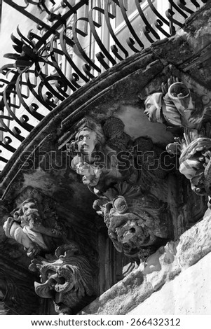 Italy, Sicily, Ragusa Ibla, the baroque facade of Cosentini Palace (Unesco monument), ornamental statues under a balcony