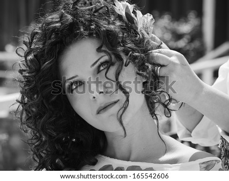 Italy, Sicily, woman combed by an 	hairdresser