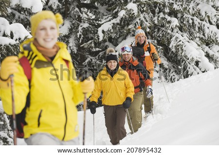 Italy, South Tyrol, Young people snowshoeing - stock photo