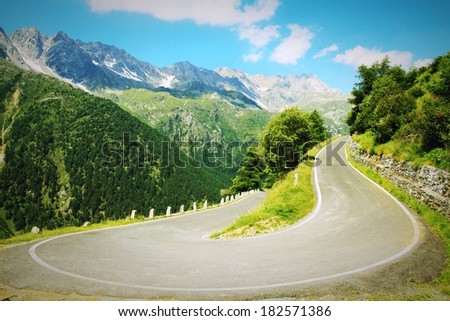 Italy, Stelvio National Park. Famous road to Gavia Pass in Ortler Alps. Alpine landscape. Cross processing color style - retro tone. - stock photo
