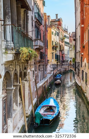 Italy. The cityscape and architecture of Venice. Urban canal and boats on it