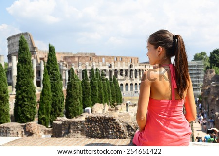 Italy travel - Woman tourist at Coliseum, Rome. Young Asian adult looking at historic landmark touristic attraction in Roma during Italian vacations. - stock photo