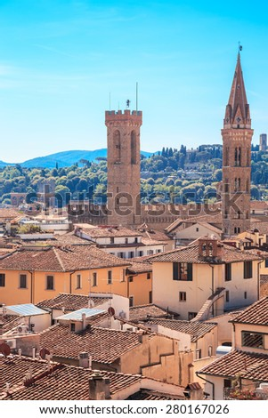 Italy, Tuscany, Florence. View from the bell tower of the Cathedral of Santa Maria del Fiore. Towers of National Museum of the Bargello and Badia Florentina - stock photo