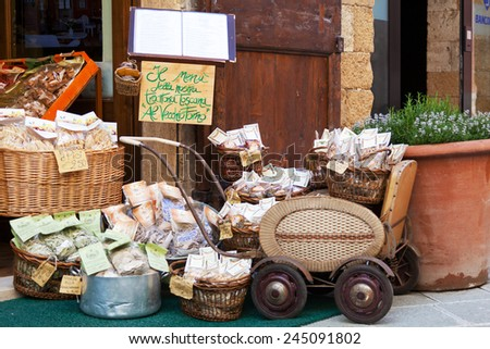 ITALY, TUSCANY - MAY 14, 2014: Tuscan souvenirs for tourists. Tuscany (Toscana), area in the Central Italy, the most visited by tourists. - stock photo