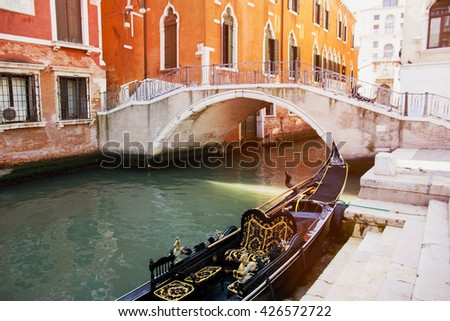 Italy. Venice. Gondola on the background of the old bridge and the historic architecture of the city