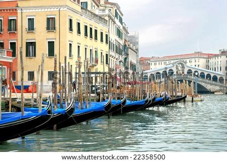 Italy Venice gondola on the grand canal with the Rialto bridge on the bottom. - stock photo