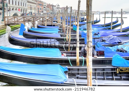 ITALY, VENICE - May 01.2014: Traditional rowing boat, symbol of city