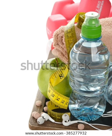 Items for sports on a white background, fitness concept - stock photo