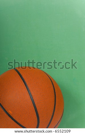Items used by a basketball coach including a ball and a black board with copy space - stock photo