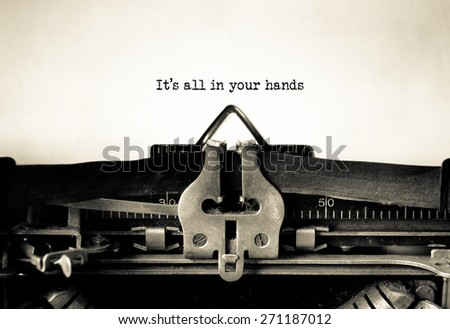 Its all in your hands message typed on vintage typewriter  - stock photo