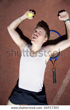 Its Game, Set And Match With The Tennis Champion Celebrating His Victory On The Hard Court Surface - stock photo