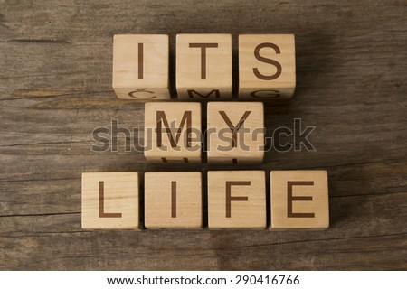ITS MY LIFE text on a wooden background - stock photo
