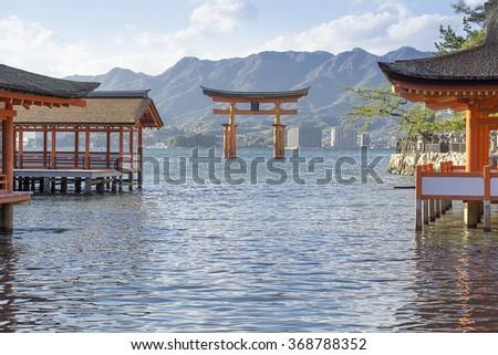 Itsukushima shrine, MIYAJIMA, JAPAN : Many unidentified travelers visit famous great Torii gate in Miyajima, Japan. Miyajima is a shinto holy site and one of the World heritage site of UNESCO. - stock photo